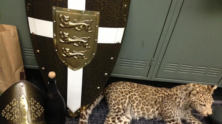 This undated photo provided by the Los Angeles County Sheriff's Department shows a few items that authorities have recovered from a huge haul of high-end swag that thieves snagged during a party at an empty mansion — including armor, shields and a stuffed snow leopard worth $250,000. (AP Photo/Los Angeles County Sheriff's Department)