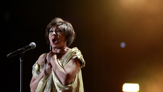 """Welsh singer Shirley Bassey performs on stage during """"Welcome to Wales,"""" the Ryder Cup celebration concert at the Millennium Stadium in Cardiff, Wednesday, Sept. 29, 2010.  (AP Photo/Matt Dunham-Pool)"""
