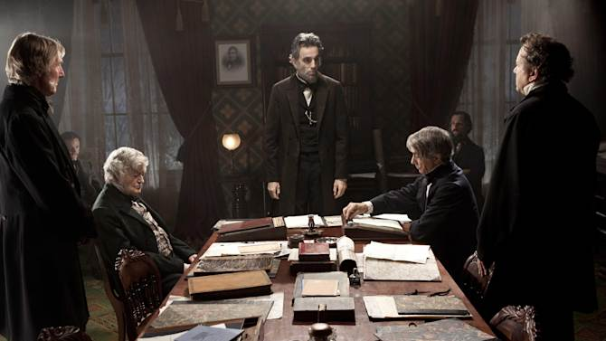 """FILE - This undated publicity photo released by DreamWorks and Twentieth Century Fox, shows Daniel Day-Lewis, center rear, as Abraham Lincoln, in a scene from the film, """"Lincoln.""""  A Congressman who saw a flaw in the movie """"Lincoln"""" says he is pleased the screenwriter has conceded an inaccuracy in its portrayal of an 1865 vote on slavery.  U.S. Rep. Joe Courtney, a Democrat who represents eastern Connecticut, said Friday, Feb. 8, 2013, he is still hoping that a correction can be made before the film is released on DVD. (AP Photo/DreamWorks, Twentieth Century Fox, David James, File)"""