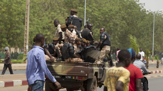 Soldiers drive through a street one week after a military coup, in Bamako, Mali Wednesday, March 28, 2012. The body representing nations in western Africa has suspended Mali and has put a peacekeeping force on standby in the most direct threat yet to the junta that seized control of this nation in a coup last week. (AP Photo/Rebecca Blackwell)