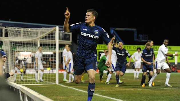 Matt Smith celebrates scoring Oldham&#39;s equaliser against Everton