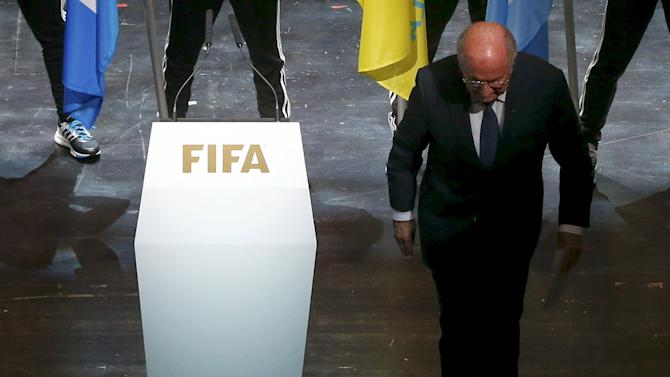 FIFA President Blatter leaves stage after making speech during opening ceremony of 65th FIFA Congress in Zurich
