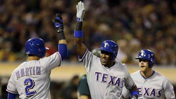 Rangers beat A's 8-3 to gain ground in AL West