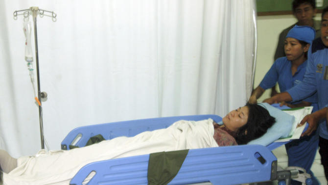A woman who was injured after a bomb went off in a church arrives at a hospital in Solo, Central Java, Indonesia, Sunday, Sept. 25, 2011. A suicide bomber attacked the church packed with hundreds of worshippers Sunday, killing himself and wounding at least 20 other people, police and hospital officials said. (AP Photo)