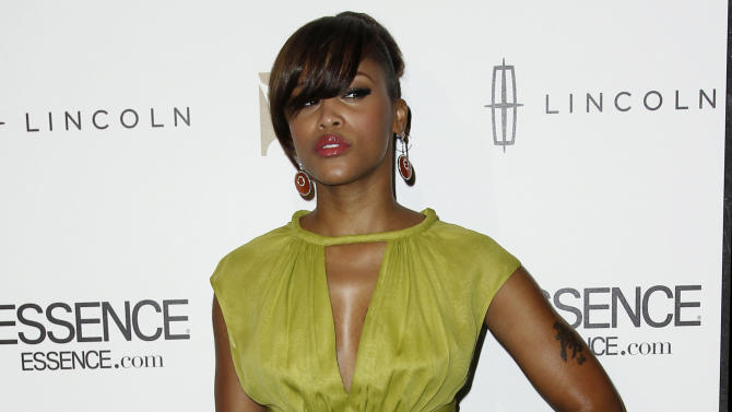 FILE - In this Feb. 8, 2012 file photo, Eve arrives at the 3rd Annual Essence Black Women in Music event in Los Angeles. The rapper-actress is engaged to British designer, Maximillion Cooper. Cooper, 41, who founded the international motor rally Gumball 3000, popped the question on Christmas Day while the couple was in the United Kingdom, a spokeswoman for Eve, 35, confirmed on Thursday, Jan. 2, 2014. (AP Photo/Matt Sayles)