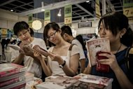 Visitors browse at the Hong Kong Book Fair in July. A potent mix of state censorship, conservative publishing choices and scant translation means international readers are given a narrow view of contemporary China, industry critics say