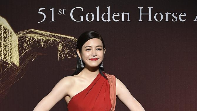 Taiwan actress Michelle Chen poses for photographers on the red carpet at the 51st Golden Horse Film Awards in Taipei