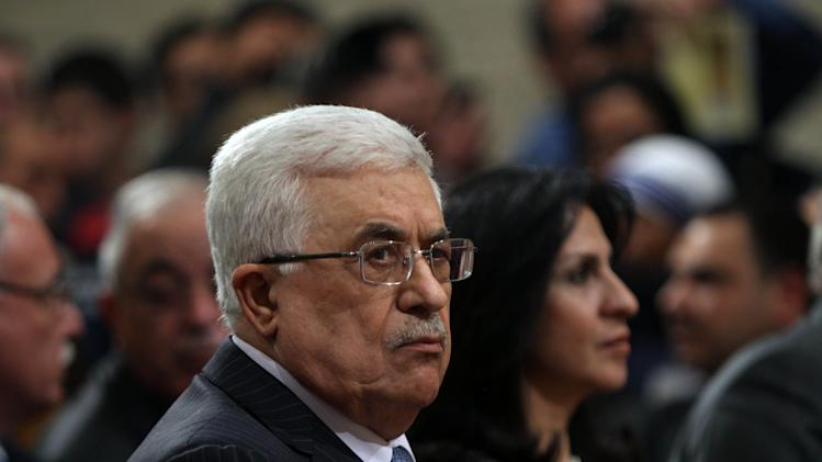 Palestinian President Mahmoud Abbas, attends Christmas Midnight Mass at Saint Catherine's Church in the West Bank town of Bethlehem, early Tuesday, Dec. 25, 2012. (AP Photo/Abed Al Hashlamoun, Pool)