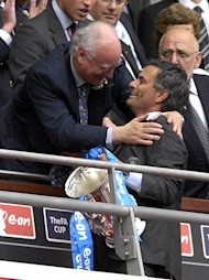 File photo dated 19/5/07 of Chelsea club chairman Bruce Buck celebrates with Chelsea manager Jose Mourinho (r) after winning the FA Cup.