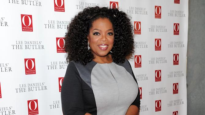 "FILE - This July 31, 2013 file photo shows media mogul and actress Oprah Winfrey at a special screening of ""Lee Daniels' The Butler"" New York. Winfrey says she ran into Swiss racism when a clerk at Trois Pommes, a pricey Zurich boutique, refused to show her a black handbag, telling one of the world's richest women that she ""will not be able to afford"" the $38,000 price tag. Winfrey earned $77 million in the year ending in June, according to Forbes magazine. (Photo by Evan Agostini/Invision/AP, File)"
