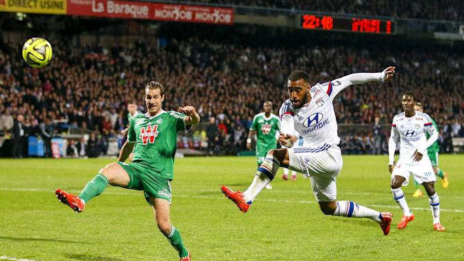 Olympique Lyon's Lacazette tries to score against Saint-Etienne during their French Ligue 1 soccer match in Lyon