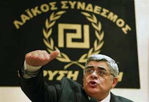 Leader of extreme-right Golden Dawn party Mihaloliakos talks to reporters at a news conference in Athens