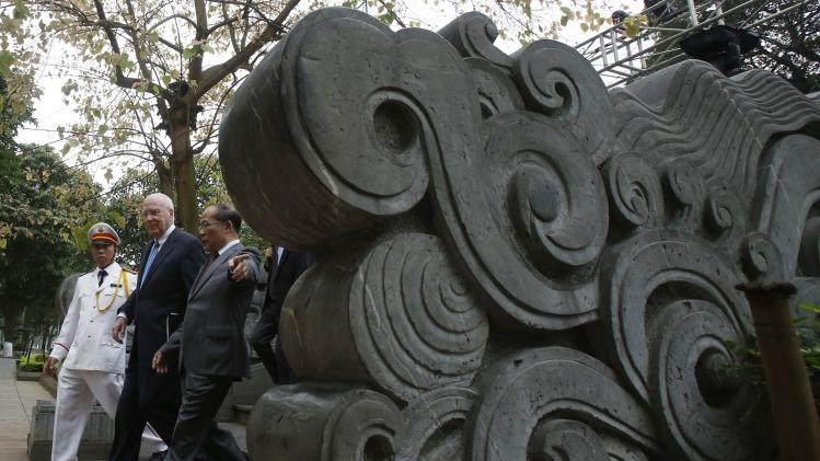 Vietnam's National Assembly Chairman Nguyen Sinh Hung guides U.S. Senate Judiciary Committee Chairman Patrick Leahy as they walk near a stone dragon around Hoan Kiem lake in Hanoi