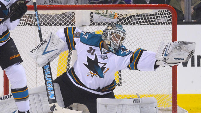 San Jose Sharks goalie Antti Niemi (31) makes a save against the Los Angeles Kings in the first period during Game 5 of the Western Conference semifinals in the NHL hockey Stanley Cup playoffs, Thursday, May 23, 2013, in Los Angeles. (AP Photo/Mark J. Terrill)