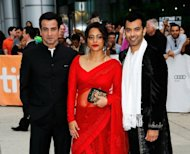 "(Left to right) Zaib Shaikh, Shahana Goswami, and Ronit Roy arrive at the ""Midnight's Children"" premiere at the 2012 Toronto International Film Festival in Toronto on September 9. The new film of Salman Rushdie's 1981 novel ""Midnight's Children"", which is set in India after independence, may not be released in the country, its director has said, blaming ""insecure politicians"""