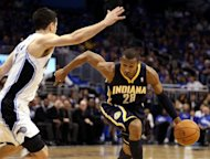 Leandro Barbosa (R) of the Indiana Pacers and Orlando Magic&#39;s JJ Redick during game three of the NBA Eastern Conference first-round playoff series on May 2. The Pacers outscored the Magic 32-17 in the third quarter and 53-36 in the second half to edge ahead in the best-of-seven series
