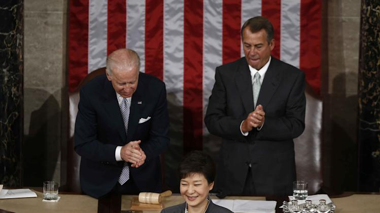 South Korea's President Park Geun-hye finishes her address to a joint session of Congress on Capitol Hill in Washington, Wednesday, May 8, 2013. At rear are Vice President Joe Biden, left, and House Speaker John Boehner of Ohio. (AP Photo/Charles Dharapak)