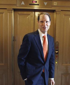 "FILE - In this Dec. 18, 2010 file photo, Sen. Ron Wyden, D-Ore., walks near the floor of the Senate on Capitol Hill in Washington. Nearly a year after the Obama administration announced an overhaul of ethics rules to deter the cozy relationship between offshore oil and gas companies and the agency that regulates them, documents obtained by The Associated Press show that ties between the industry and its regulator persist. ""Our sense is the revolving door is still swinging too widely,"" said Wyden, in an interview with AP, after reviewing the recusals. (AP Photo/Alex Brandon, File)"