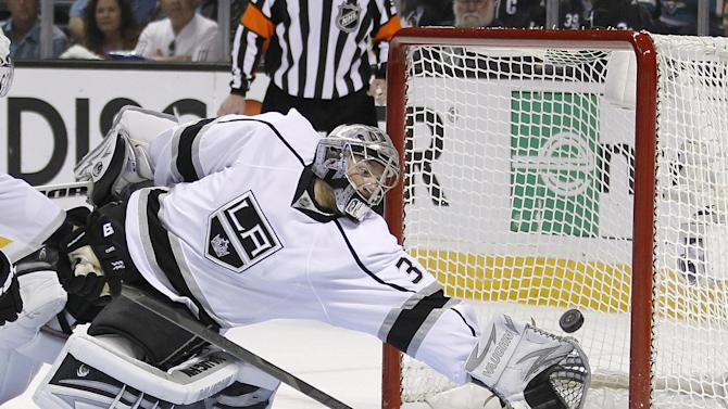Los Angeles Kings goalie Jonathan Quick (32) can't stop a San Jose Sharks center Joe Thornton (19) score during the first period in Game 6 of their second-round NHL hockey Stanley Cup playoff series in San Jose, Calif., Sunday, May 26, 2013. (AP Photo/Tony Avelar)
