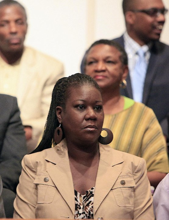 Trayvon Martin's mother, Sybrina Fulton listens during a community forum on slain Florida teenager Trayvon Martin, 17, at the Macedonia Baptist Church in Eatonville, Fla., Monday, March 26, 2012. Stud