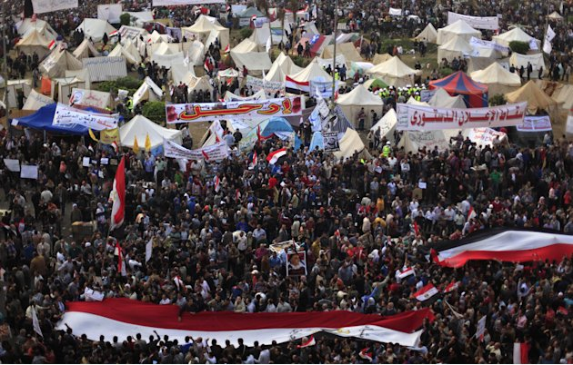 Egyptian protesters attend an opposition rally in Tahrir Square in Cairo, Egypt, Tuesday, Nov. 27, 2012. Thousands flocked to Cairo's central Tahrir square on Tuesday for a protest against Egypt's pre