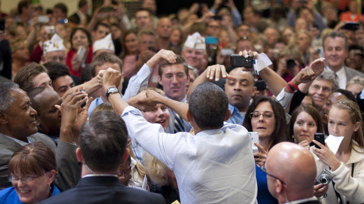 President Barack Obama greets supporters after speaking about jobs for veterans, Friday, June 1, 2012, at Honeywell Automation and Control Solutions Global Headquarters in Golden Valley, Minn.  (AP Photo/The Star Tribune, Glen Stubbe, Pool)