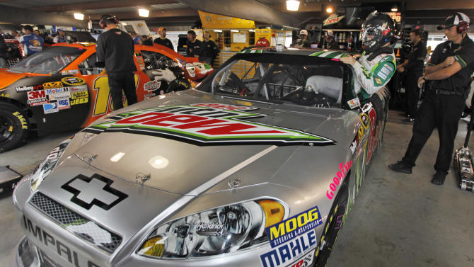 Dale Earnhardt Jr., gets into his car prior to his first practice since recovering from concussions, at Martinsville Speedway in Martinsville, Va., Friday, Oct. 26, 2012.  (AP Photo/Steve Helber)