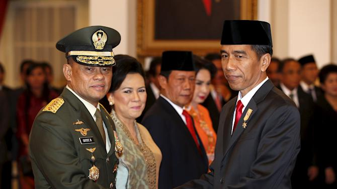 Indonesian President Joko Widodo shakes hands with General Gatot Nurmantyo, after being sworn in as the new armed forces chief, at the presidential palace in Jakarta, Indonesia