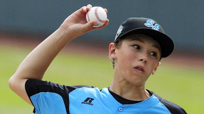 Goodlettsville, Tenn., pitcher Justin Smith delivers against Tokyo in the first inning of the Little League World Series championship baseball game in South Williamsport, Pa., Sunday, Aug. 26, 2012. (AP Photo/Gene J. Puskar)