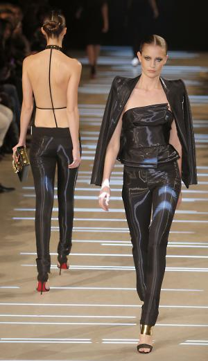 FILE - In this Tuesday, Jan. 22 2013 file photo, models wear creations by French fashion designer Alexandre Vauthier as part of his Women's Spring/Summer 2013 Haute Couture fashion collection, in Paris. If it isn't already daunting enough to pack for a trip to fashionable Paris, female visitors, beware: It's illegal to wear pants. So says a law dating from 1800 that has never been taken off the books _ only relaxed to allow women the comfort of two legs when riding bicycles or horses. (AP Photo/ Jacques Brinon, File)