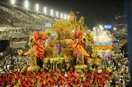Revelers of Unidos da Tijuca samba school perform during the first night of Carnival parade at the Sambadrome in Rio de Janeiro, Brazil on February 10, 2013. As world celebrities watched, top samba schools paraded their elaborate fantasy floats and scantily-clad beauty queens in the fiery highlight of the Rio Carnival