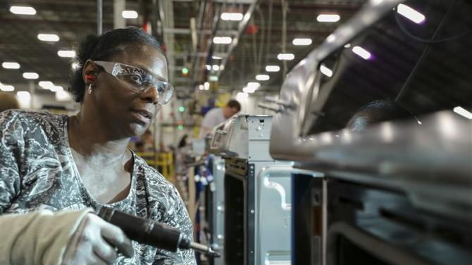 Belinda Hall assembles the trim on an oven range at a Whirlpool manufacturing plant in Cleveland