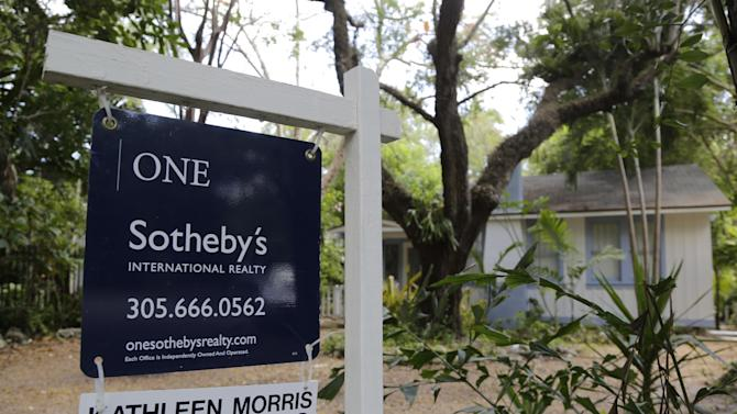 This Monday, May 19, 2014 photo shows a home for sale in the Coconut Grove neighborhood of Miami. Standard & Poor's/Case-Shiller reports on U.S. home prices in March and for the first quarter of the year on Tuesday, May 27, 2014. (AP Photo/Lynne Sladky)