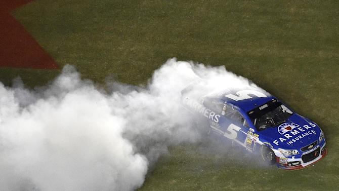 Sprint Cup Series driver Kasey Kahne does a burnout after winning a NASCAR Sprint Cup auto race at Atlanta Motor Speedway, Sunday, Aug. 31, 2014, in Hampton, Ga