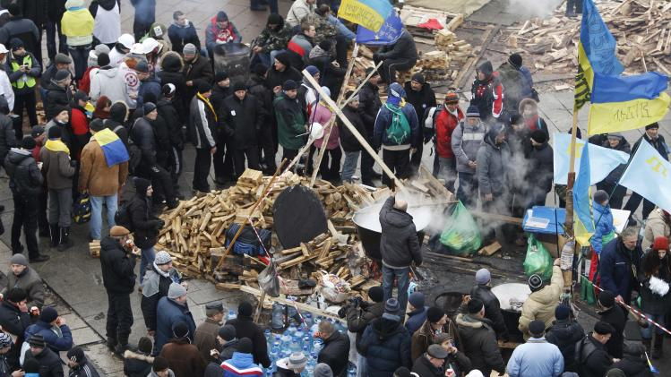 Pro-European integration protesters gather at a meal area during a rally in central Kiev