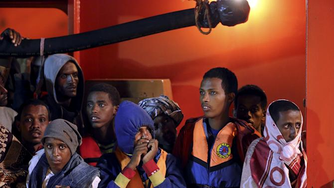 Migrants waits to disembark from tug boat Asso29 in the Sicilian harbour of Pozzallo