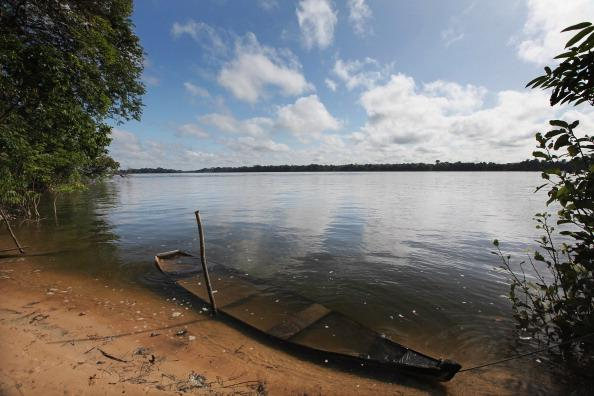 An old boat is submerged in the Xingu River near the site where the Belo Monte dam complex is under construction in the Amazon basin on June 14, 2012 near Altamira, Brazil. Belo Monte will be the world's third-largest hydroelectric project and will displace up to 20,000 people while diverting the Xingu River and flooding as much as 230 square miles of rainforest.