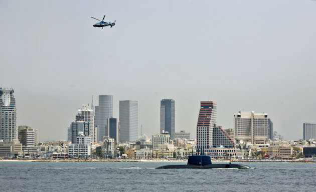 FILE - In this May 5, 2008 file photograph, a dolphin class Israeli submarine sails down the coast during a military demonstration in Tel Aviv, Israel. Israel on Thursday May 3, 2012 received its fourth German-made submarine capable of launching nuclear warheads, expanding a fleet that experts say could be used in an attack on Iran. (AP Photo/Tara Todras-Whitehill, File)