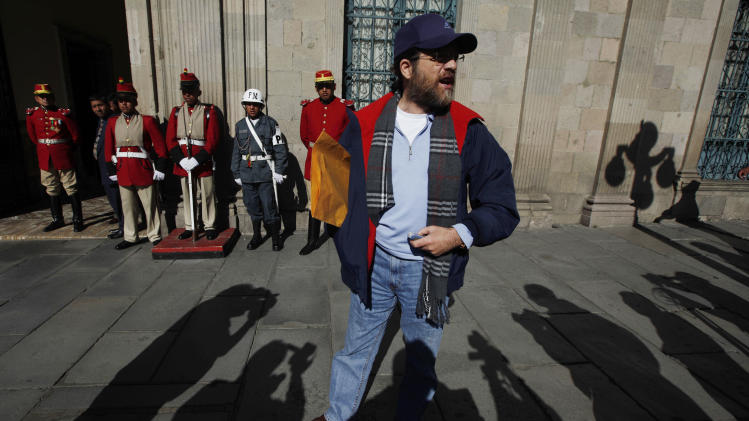 In this May 23, 2013 file photo, Jacob Ostreicher, a New York businessman, arrives to the government palace to deliver a letter to Bolivia's President Evo Morales in La Paz, Bolivia. Bolivia's government expressed outrage over Ostreicher's mysterious departure from the Andean nation, calling him a fugitive who sneaked across the border into Peru with the help of unknown groups. (AP Photo/Juan Karita, File)