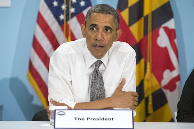President Barack Obama attends a roundtable at the Center for Urban Families (CFUF) in Baltimore, Friday, May 17, 2013, during his second &quot;Middle Class Jobs and Opportunity Tour&quot;. CFUF is a Baltimore 