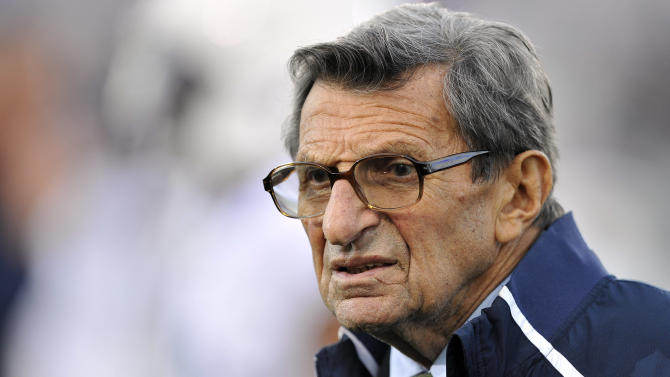"""FILE - In this Oct. 22, 2011 file photo, Penn State coach Joe Paterno stands on the field before his team's NCAA college football game against Northwestern, in Evanston, Ill. Paterno's doctors say that the former Penn State coach's condition has become """"serious,"""" following complications from lung cancer in recent days. (AP Photo/Jim Prisching, File)"""