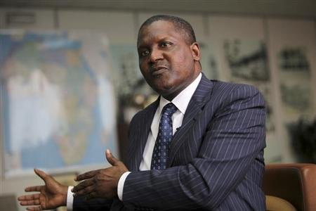 Nigerian billionaire Aliko Dangote gestures during an interview with Reuters in his office in Lagos June 13, 2012. REUTERS/Akintunde Akinleye