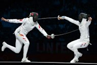 South Korea's Shin A Lam (R) fences against China's Sun Yujie during their Women's Epee bronze medal bout as part of the fencing event of London 2012 Olympic games, at the ExCel centre in London