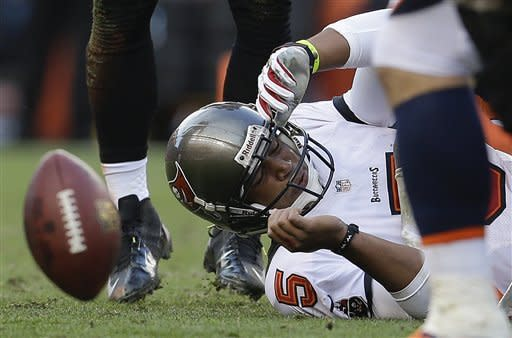 Manning throws 3 TDs as Broncos top Bucs 31-23