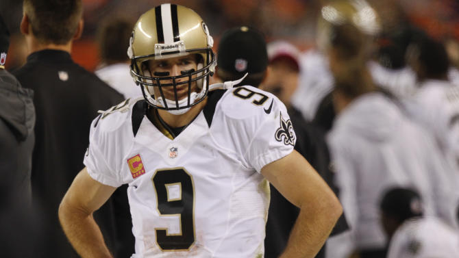 New Orleans Saints quarterback Drew Brees (9) stands on the sidelines in the fourth quarter of an NFL football game against the Denver Broncos, Sunday, Oct. 28, 2012, in Denver. (AP Photo/David Zalubowski)
