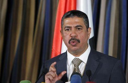 Yemen's newly appointed Prime Minister Bahah listens to a reporter's questions at a news conference in Sanaa