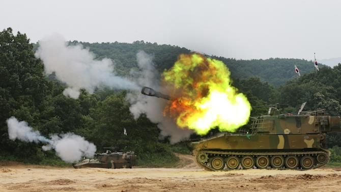 South Korean army's K-55 A1 self-propelled howitzers fire during a military exercise to mark the 63rd anniversary of the start of the Korean War in Yeoncheon near the demilitarized zone that divides the two Koreas, South Korea, Tuesday, June 25, 2013. The three-year Korean War broke out on June 25, 1950 when Soviet tank-led North Koreans invaded South Korea. (AP Photo/Yonhap, Lim Byung-shick) KOREA OUT