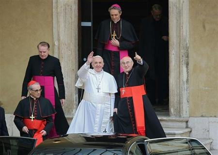 Newly elected Pope Francis, Cardinal Jorge Mario Bergoglio of Argentina waves from the steps of the Santa Maria Maggiore Basilica in Rome, March 14, 2013. At left is Cardinal Santos Abril of Spain and Cardinal Agostino Vallini, Vicar General of Rome at right. REUTERS/Alessandro Bianchi