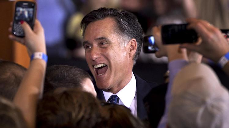 Republican presidential candidate, former Massachusetts Gov. Mitt Romney reacts while greeting supporters at a rally in Schaumburg, Ill., after the winning the Illinois Republican presidential primary, Tuesday, March 20, 2012.  (AP Photo/Steven Senne)