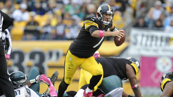 Pittsburgh Steelers quarterback Ben Roethlisberger (7) scrambles Philadelphia Eagles defensive tackle Cullen Jenkins (97) in the second quarter of an NFL football game on Sunday, Oct. 7, 2012, in Pittsburgh. (AP Photo/Don Wright)